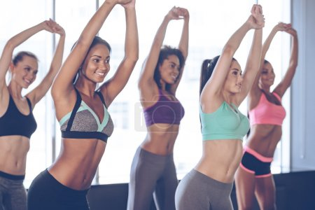 Women doing stretching at gym