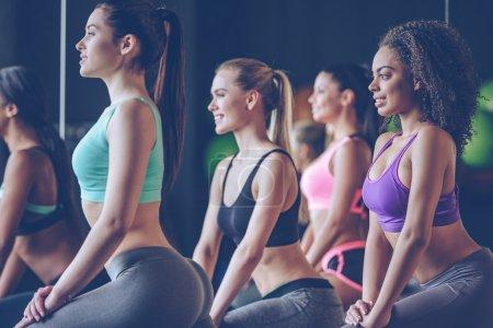 Beautiful young women exercising at gym