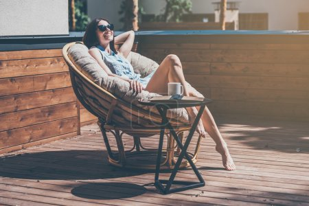 woman relaxing in a big comfortable chair