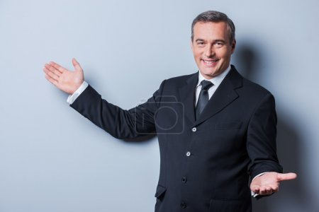 Cheerful mature man in formalwear