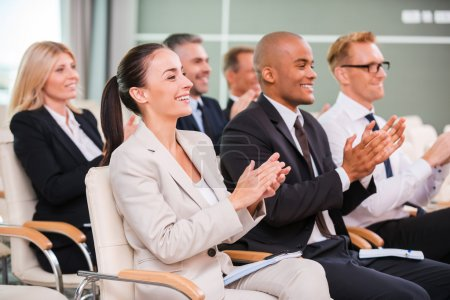 Group of happy business people applauding