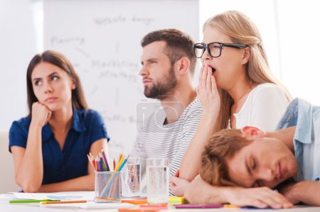 Business people on boring presentation.