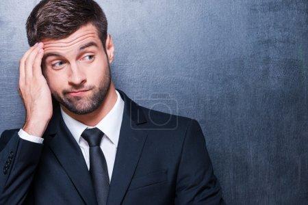 Frustrated man in formalwear