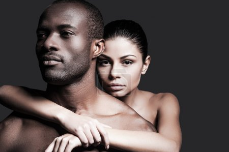 Caucasian woman bonding to African man
