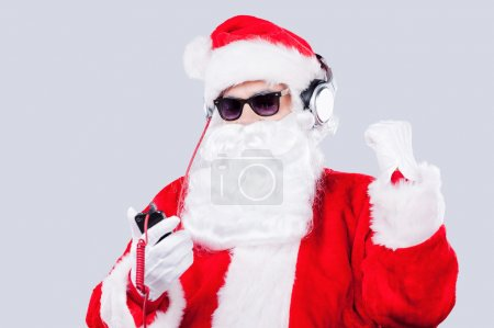Santa Claus ilistening to MP3 Player