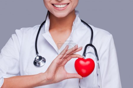 Female doctor  holding heart prop