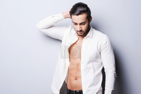 Man in unbuttoned shirt