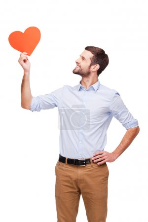 Man holding heart Valentine card