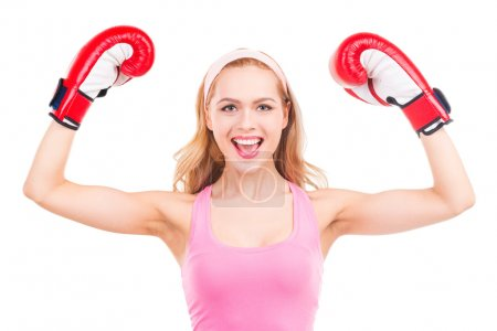 Blond woman in boxing gloves
