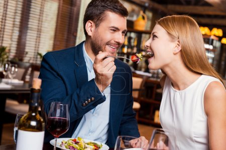 Couple enjoying dinner at restaurant