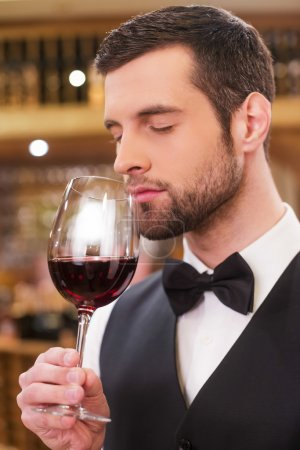 Man holding glass with red wine