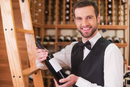 Man holding bottle with wine