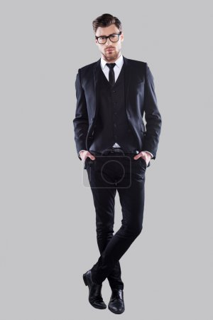 Photo for Full length of confident young man in formal wear and eyeglasses holding hands in pockets and looking at camera - Royalty Free Image