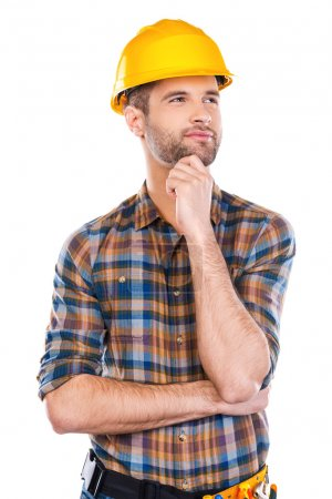 Thoughtful young male carpenter