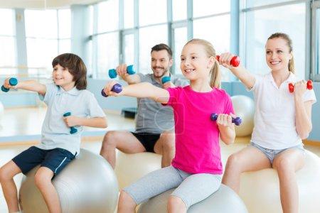 Happy sporty family exercising