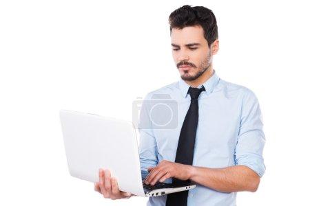 Man in shirt working on laptop