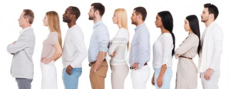 Photo for Waiting in a row. Side view of confident diverse group of people in smart casual wear looking away while standing in a row against white background - Royalty Free Image