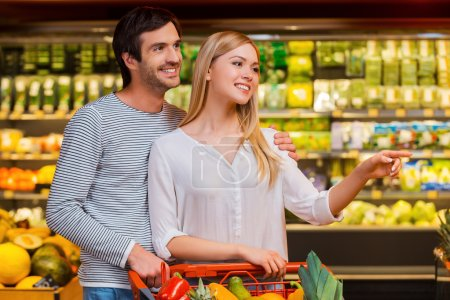 Woman and her boyfriend in food store