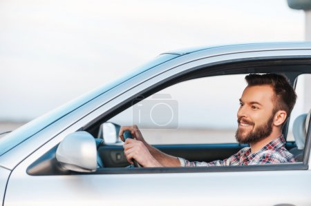 young man driving his car