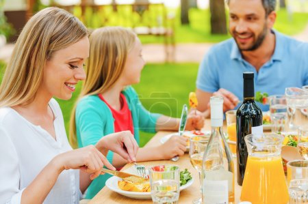 Happy family enjoying meal together