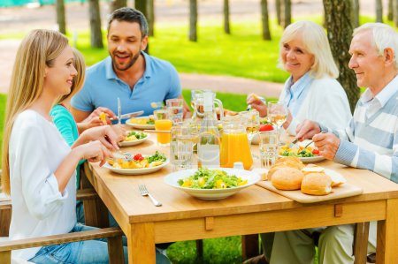 family communicating and enjoying meal