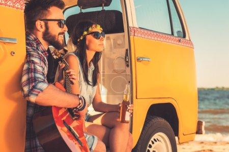 couple sitting in their retro minivan