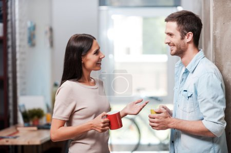 people holding coffee cups and talking