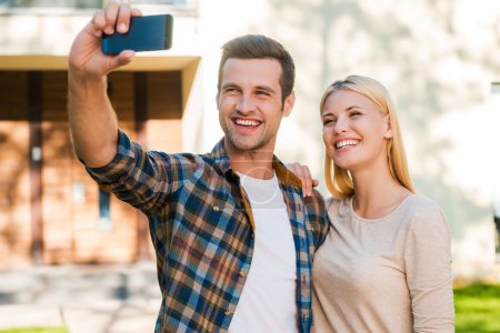 couple making selfie by smart phone