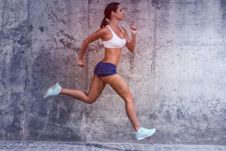 Woman in sports clothing running