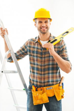 Manual worker holding hand on ladder
