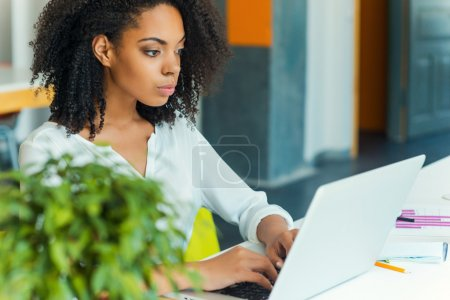 African woman working on laptop