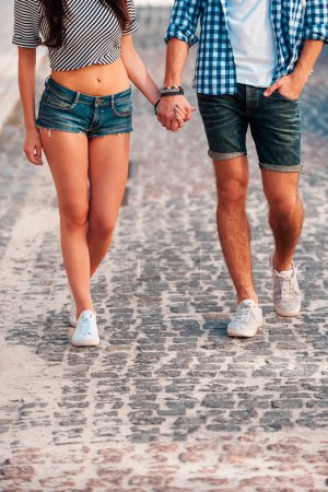 young loving couple holding hands