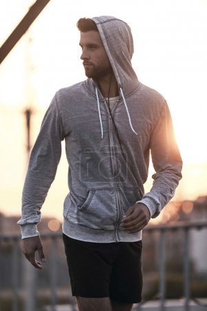 man in sports clothing walking outdoors