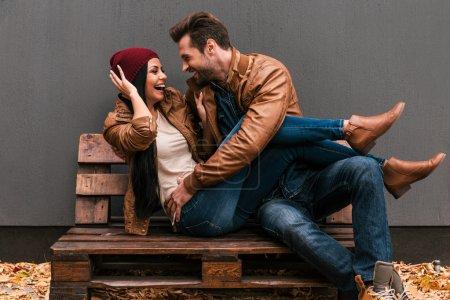 loving couple sitting on wooden pallet