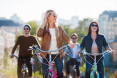 woman riding bicycle with friends