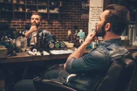 Photo for Looking good. handsome young bearded man in barbershop - Royalty Free Image
