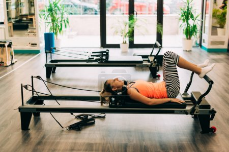 Woman in a pilates class
