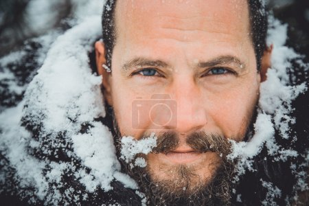Portrait of a young handsome man with a beard. A p...