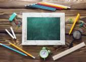 School supplies objests back to school blackboard on wooden back