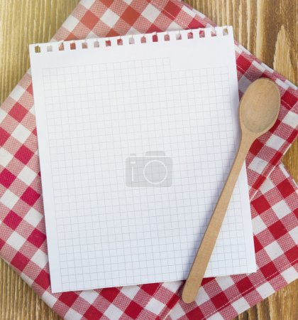 Photo for Recipe white page on picnic cloth on wooden background.Paper with copyspace for kitchen notes.Clean blank. - Royalty Free Image