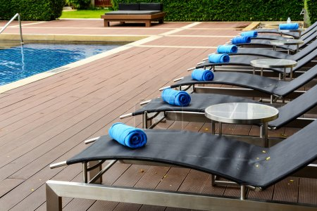 Towel on sun bed at poolside