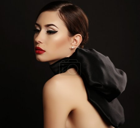 Photo for Fashion studio photo of gorgeous sexy woman with dark hair and bright makeup, in luxurious black dress - Royalty Free Image