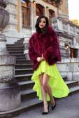 beautiful elegant woman in luxurious fashion red fur coat