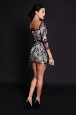beautiful brunette woman wearing elegant lace dress