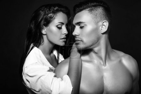 black and white fashion photo of sexy impassioned couple