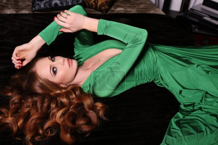 gorgeous red haired woman in elegant green dress