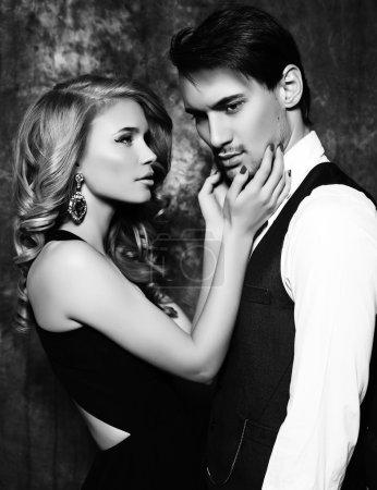 beautiful sensual couple in elegant clothes posing in studio