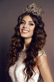 Gorgeous young woman with luxurious hair with victress crown