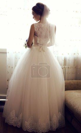 beautiful sensual bride with dark hair in luxurious lace wedding dress