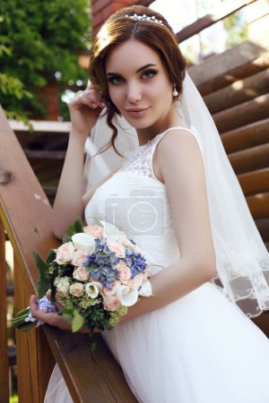 beautiful sensual bride with dark hair in luxurious  wedding dress